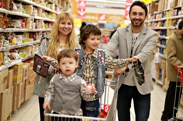 A Young Couple Shopping for Groceries with Their Small Children